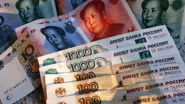 РТ: Трговина у рубљама и јуанима између Русије и Кине чини долар споредном валутом