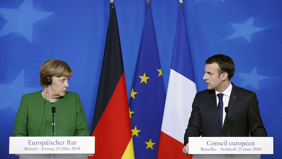 """РТ: Меркелова и Макрон уверени у лондонски """"доказ"""" за кривицу Русије"""