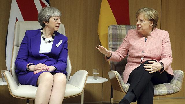 """Мејова и Меркелова договориле заједничко супротстављање """"растућој руској агресији"""""""