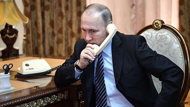 Путин и Порошенко разговарали о ситуацији у Донбасу