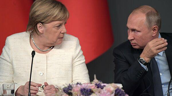 """Путин и Меркелова разговарали о Минским споразумима и """"Северном току 2"""""""