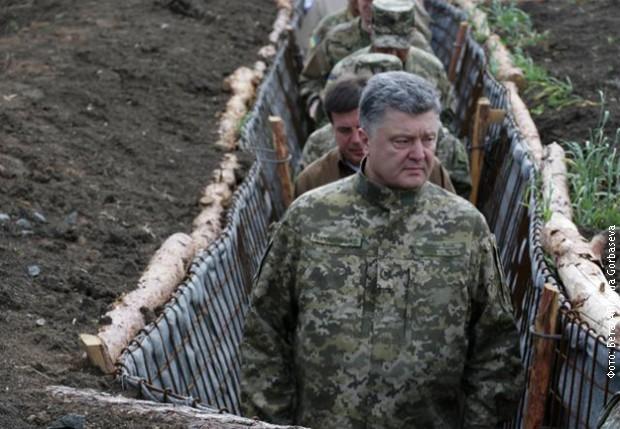 Порошенко: Сукоб у Донбасу није замрзнут, тамо се води прави жесток рат