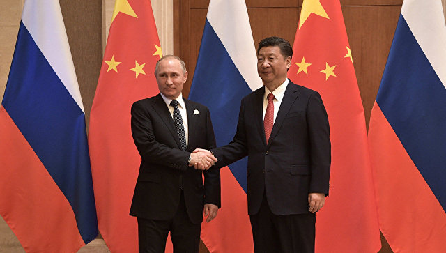 Путин стигао у Пекинг